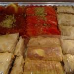 half tray combo of baklava, kunafa, burma and znoob that we ordered to go.