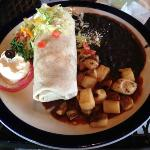 Chicken burrito (flavorless), black beans (from a can) & fried potatoes (frozen from a bag).