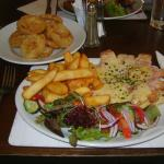 My partners meal 1 (Gammon steak topped with cheese, with chips, salad and onion rings £12.75)