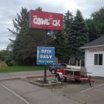 Cowlick - sign out front (and smoker)