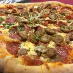 House made brick oven baked pizza pies dine in or Carry out