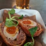 Crispy Scotch Egg with runny yolk.