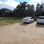 Parking lot beside rustic romance cabin