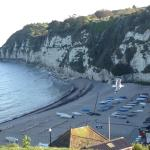 The beach is pebbly with lots of nesting seabirds in the cliffs & the anchor pub overlooks with