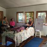 Karen teaching CranioSacral therapy at Alas y Raices yoga studio in Monteverde