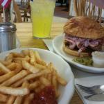 Three little piggies sandwich. Breaded pork tenderloin shaved ham and bacon on a Hawaiian sweet