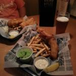 Fish and chips with mushy peas and draft beers