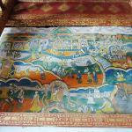 """曼宰竜缅寺,亦称""""中缅寺"""",与勐遮镇政府同在一街道""""国防路(至西定章郎公路)上,邻曼吕佛寺。壁画据传绘于傣历1230年(公元1868年),由七幅色彩艳丽的佛经故事组成,傣家民间艺风鲜明,州级文"""