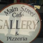 Main Street Cafe & Pizzeria sign in window.