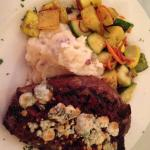Candied bacon rib eye with garlic mashed potatoes and vegetable.