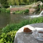 Enjoying a cuppa and a slice of cake by the river