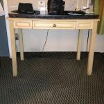splay-legged desk with heavy marble top