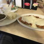 Chicken fried steak with green beans and mashed potatoes