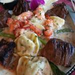 STEAK TIPS & LOBSTER SCAMPI Grilled steak tips & lobster meat in scampi butter sauce, with spina