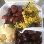 $9 U.S. for Oxtail Stew, cassava, veggie rice, and fried plantain. I also put garlic sauce and p