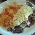 Prime rib Omelette stuffed with onions, bacon, mushrooms, red and green bell peppers and cheese!