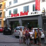Taking a group photo in front of the hotel