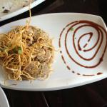Arroz Chaufa: pollo Fusion of Peruvian/Chinese style fried rice egg veggies garnished with crisp