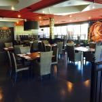 Electronic ambient music adds to the atmosphere of this open floor plan restaurant.