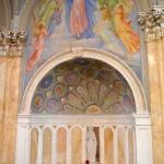 To the left of the main altar.