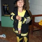 In the fireman garb ready to climb on the truck
