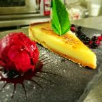 Homemade lemon tart with blackcurrant sorbet