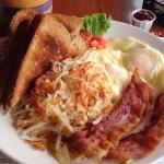 Nummy eggs, bacon and toast with 9-grain toast and raspberry jam!