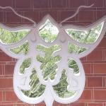 Butterfly-shaped window in the garden
