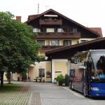 Hotel Attergauhof, St Georgen, rear of hotel with back patio behind parked coach.