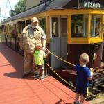 Grandpa and boys board the trolley.