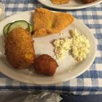 My first plate full from our family style servings. Includes catfish, coleslaw, hush puppy, frie
