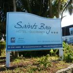 The entrance sign to Saints Bay