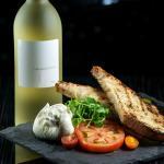 "Wine-it-Up Wednesdays! $5 off bottles of house wine & ""Italian Tapas"" Menu Specials"