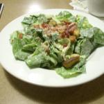 Caesar salad with real bacon bits and garlic toasted into the butter.