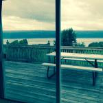 View of lake from kitchen sliding doors to deck. Good place for morning coffee if its raining.