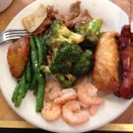 Combination of items: shrimp, egg roll, sweet plantain, green beans, chicken with broccoli, pepp