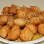 "greek speciality ""Loukoumades"" with honey and cinnamon"