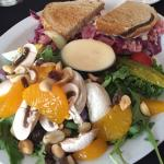 Rueben sandwich with a side of spinach and Mandarin salad