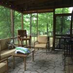 A wonderful screen porch with flat screen TV and fan.