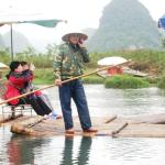 Globalization - Yulong River boatman on cell phone