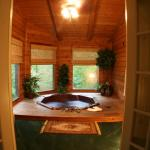 "Private hot tub inside one of our ""Cupid's Hideout"" cabins"