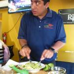 Making Guacamole with Avacado, Cilanteo, Tomato, Onion, Mango and Special Seasonings. Delicious