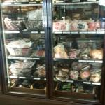 This is one of the many coolers full of meats ready to take home with you.