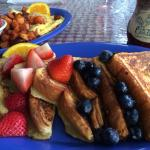 The Most French Toast with blueberries and strawberries