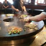 Grill warriors cooking Mongolian dishes on the flat top
