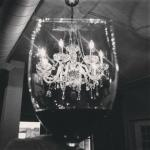 Everything sparkles beneath a chandelier.