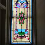 Beautiful stained glass at end of hallway