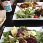 Roasted beet salad with goat cheese and pecans, fish cakes with Mediterranean salad