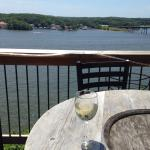 Enjoying the view and some Pinot Grigio from the deck.