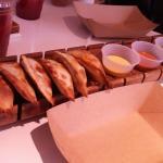 Canoe of empanadas and sauces